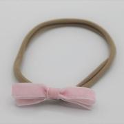Nylon haarbandje roze velvet strikje