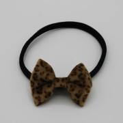 Zwart haarbandje met leopard strik