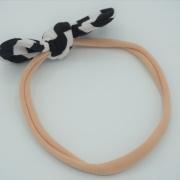 Roze haarband gestreepte strik