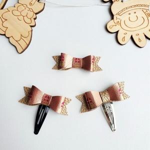 Haarspeldje Sinterklaas strik roségoud